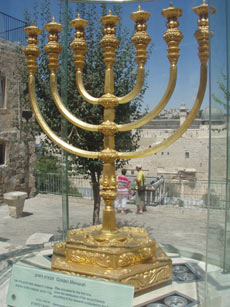 The Golden Lampstand which was present in old temple but damaged, was restored to its original form, kept outside the temple area.