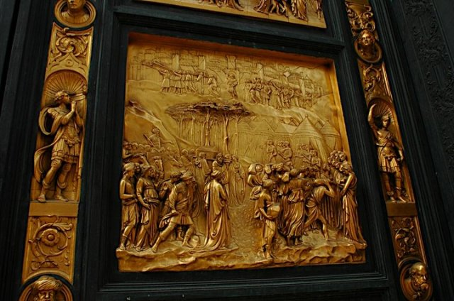 A close up of the bronze panel depicting the story of Joshua, with the arc of the covenant and the city of Jericho. Joshua lived a righteous life in the name of God and because of this, he was able to destroy all of his enemies and reclaim the Promised Land.